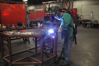 Working welding a piece of metal
